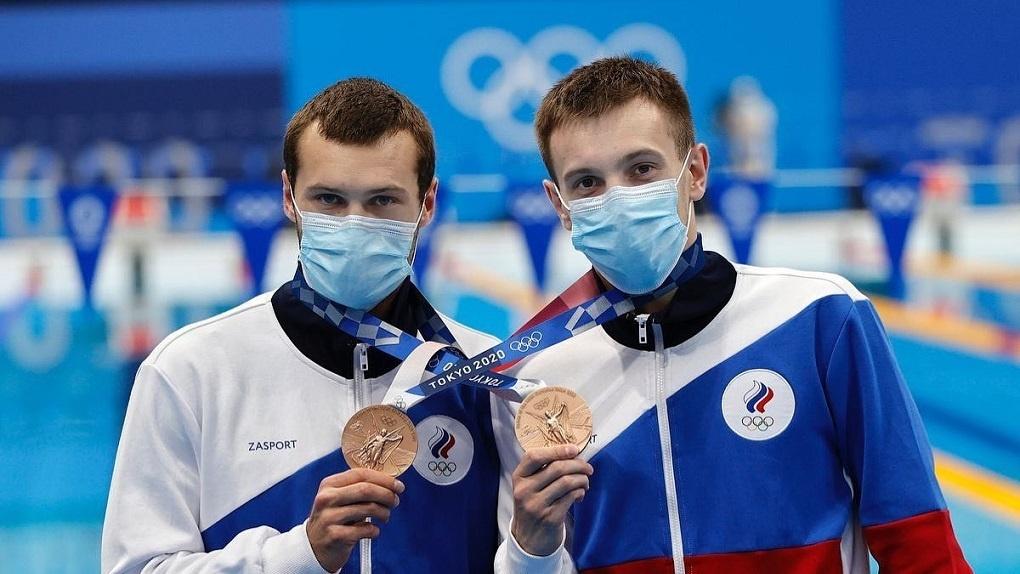 Россияне Александр Бондарь и Виктор Минибаев выиграли бронзу Олимпиады по синхронным прыжкам в воду