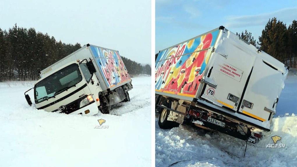 Водитель рефрижератора вторые сутки живет на трассе в надежде вытащить машину из снежного плена