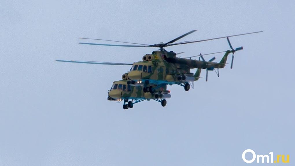 Боевые вертолёты над Омском озадачили жителей города