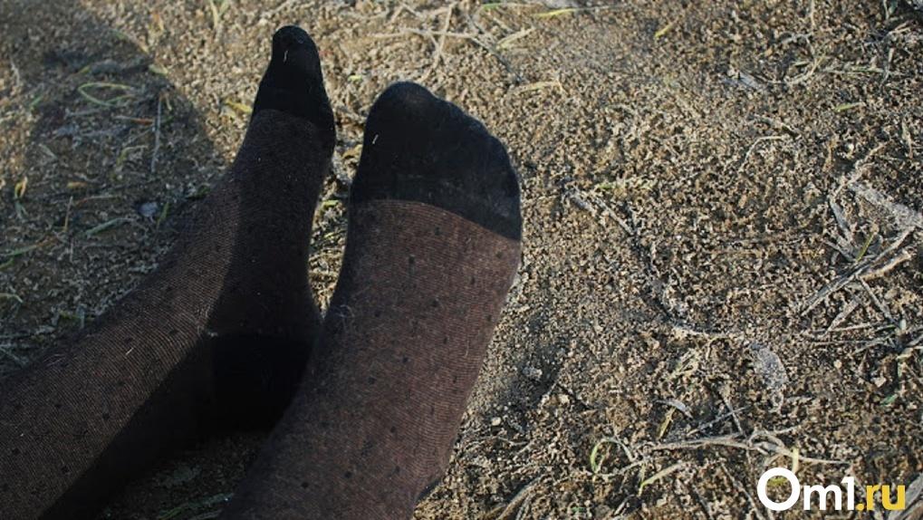 Омичи нашли на улице мёртвое тело женщины